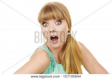 Concerned scared shocked woman. Emotional facial expression wide eyed girl surprised open mouth isolated on white