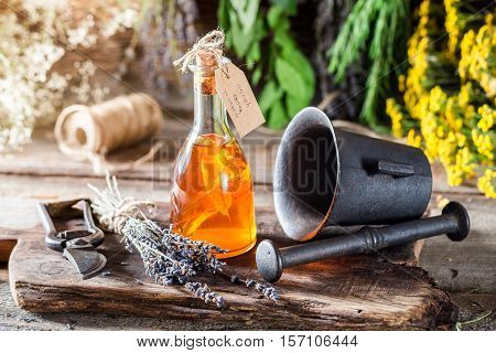 Aromatic Herbs In Bottles With Alcohol And Herbs