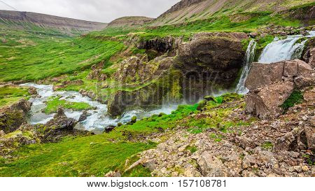 Water Cascade In The Mountains In Iceland