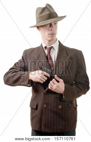 gangster in a suit vintage with handgun isolated on white background