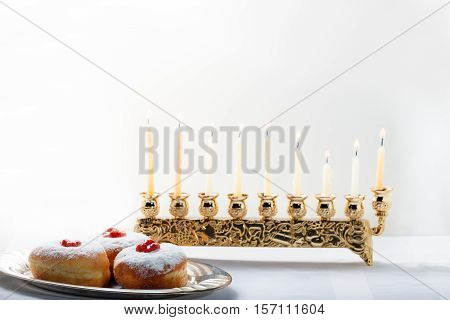 Sufganiyot and nine branched menora for Hanukkah