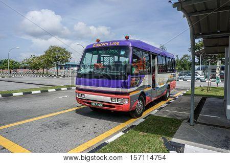 Muara,Brunei-Nov 10,2016:Bus waiting for passengers in Serasa Ferry Terminal at Muara,Brunei Darusallam on 10th Nov 2016.The terminal is about 25km from Bandar Seri Begawan town,Brunei Darussalam.
