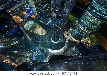 MOSCOW - MAY 21, 2015: Central core in illuminated Moscow International Business Center at night. Years of construction of complex - 1995-2018