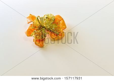 orange and yellow bow ribbon isolated on the white background