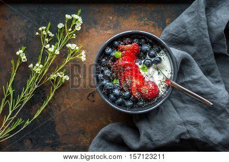 Greek yogurt with berries and hemp seeds. A healthy snack or meal.
