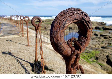 Rusty bollards on Newcastle beach, NSW, Australia