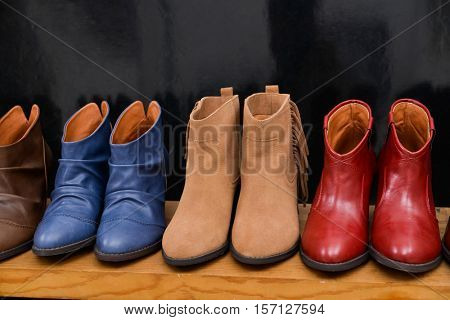 Women's leather boots on wooden