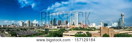 Panorama of the Dallas Texas Skyline on a partly cloudy day.