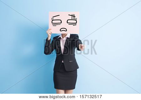 business woman take tired billboard and finger pointing to youisolated blue background