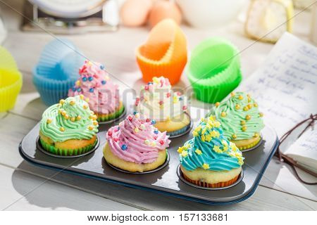 Preparation For Tasty Cupcakes With Cream On Old Wooden Table