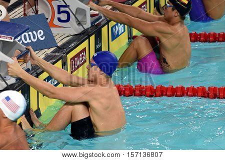 Hong Kong China - Oct 29 2016. Australian olympian world champion and record holder Mitch Larkin at the start. FINA Swimming World Cup Preliminary Heats Victoria Park Swimming Pool.