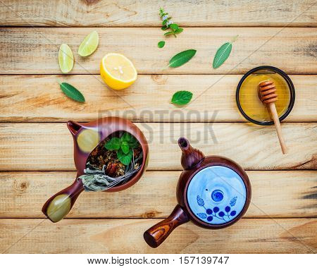 Assortment Of Dried Herbal Tea. Herbal Tea Pots With Fresh Herbs Sage ,peppermint , Honey, Lime And