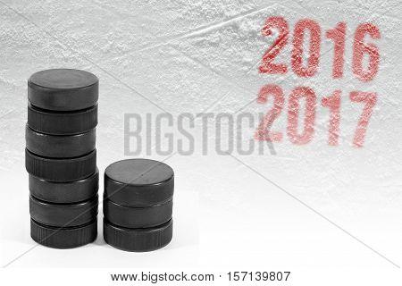 Season 2016-2017 year and hockey puck on ice. Concept hockey