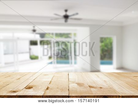 table top and Blurred abstract background interior view looking out toward to empty office lobby and entrance doors and glass curtain wall with frame: Blurry perspective of reception hall to building entry/ exit