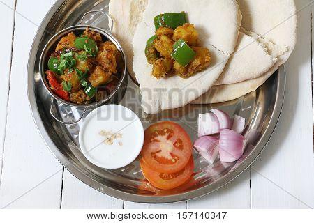 Potato curry aloo with indian roti / chapati / fulka / paratha / pita / naan / indian bread, indian spicy food