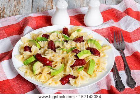 Italian Sausage Bowtie Pasta Warm Salad With Avocado Slices