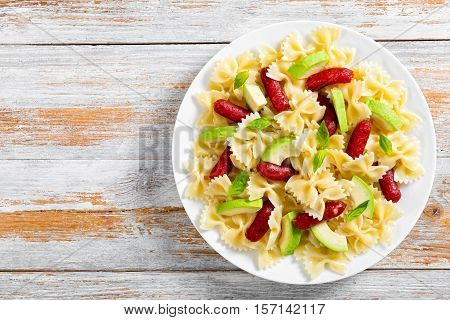 Farfalle Pasta Warm Salad With Avocado Slices And Basil