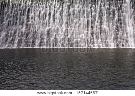 Detail of the cascade of water to spillway of the dam