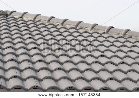 Rows of roof tiles on the top of house Isolated white background.