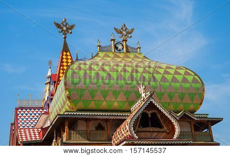 Roof ancient Russian terem and towers and wind vane in the form of double-headed eagles