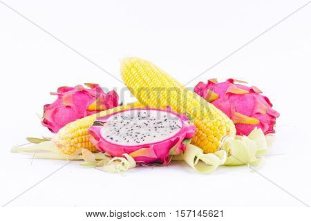 sweet corn cobs kernels and dragon fruit pitaya on white background  fruit and vegetable isolated food