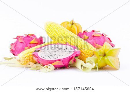 sweet corn cobs kernels and dragon fruit pitaya and star fruit carambola  on white background  fruit and vegetable isolated food