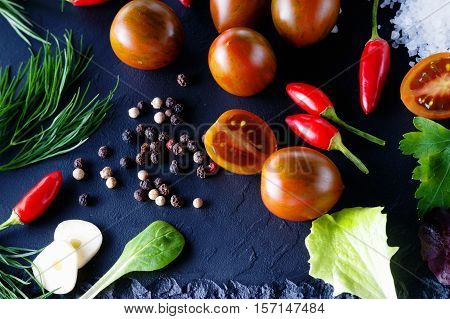 Photography of a vegetables mix on the stone plate