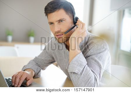 Sales representative working from home on laptop computer