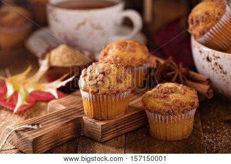 Seasonal cinnamon streusel muffins with tea in a rustic setting
