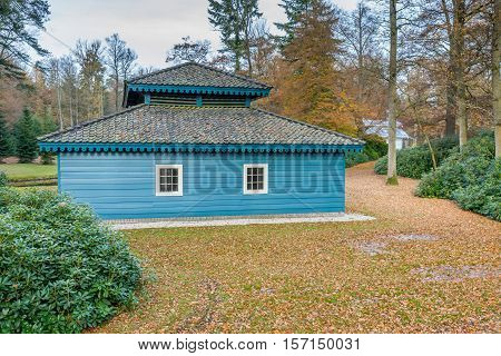 Historic architectural boathouse in the autumn forest at a national royal park. Netherlands