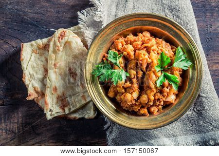 Indian Channa Masala With Chickpeas On Old Wooden Table