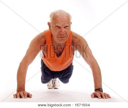 Strong senior man doing push-ups on the floor. Isolated on white. poster