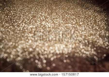 Gold Festive blur background. Abstract night twinkled bright background with bokeh defocused golden lights.