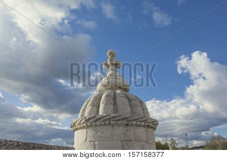 Beautiful cloudy sky seen from Belem Tower Manueline style pinnacle in Lisbon