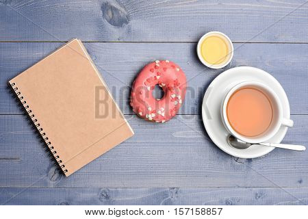 Donut, Tea With Honey And Notepad