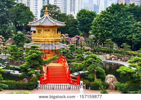 Traditional chinese house in public Nan Lian Garden, Hong Kong, China and bonsai trees panorama
