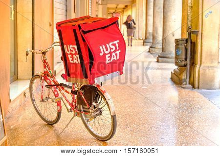Bologna italy oct 16 2016: a JUST EAT container on a bike used for the deliveries under the Bologna's porticos. JUST EAT s an online food order and delivery service based in UK