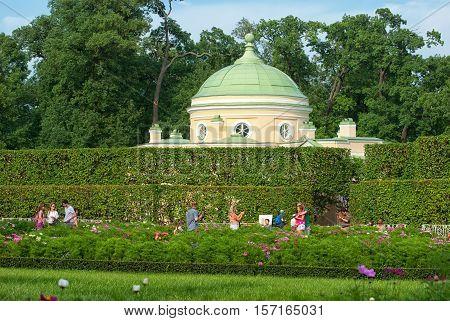 TSARSKOYE SELO, SAINT - PETERSBURG, RUSSIA JULY 25, 2016: People take pictures near the Lower Bathhouse Pavilion in Catherine Park. The Tsarskoye Selo is State Museum-Preserve