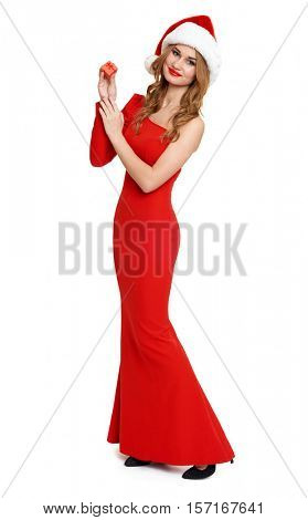 beautiful girl in red gown and santa hat isolated on white background, christmas holiday concept, show little gift box