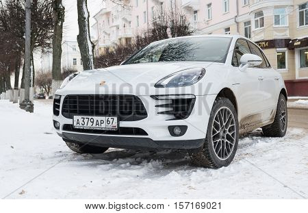 Smolensk, Russia - November 12, 2016: Porsche Cayenne parked in winter street. Mid-size luxury crossover sport utility vehicle produced by the German manufacturer Porsche since 2002.