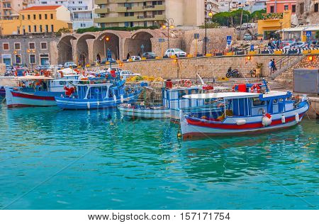 HERAKLION GREECE - OCTOBER 16 2013: The evening port is the crowded place full of tourists and fishermen on October 16 in Heraklion.