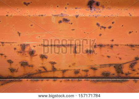 A rusty red metal peeling background texture.