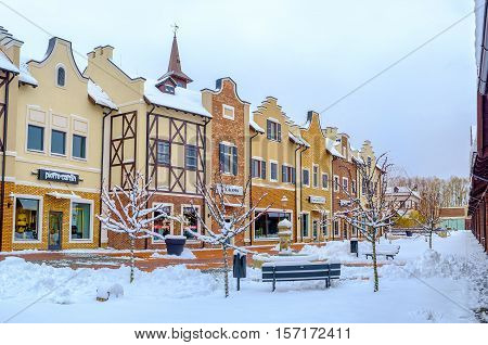 KIEV UKRAINE - NOVEMBER 11 2016: Winter is the nice time for shopping in scenic Dutch style outlet city on November 11 in Kiev.