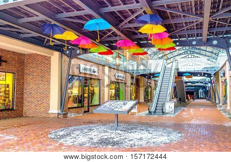 KIEV UKRAINE - NOVEMBER 11 2016: The covered gallery in Dutch style outlet city decorated with colorful umbrellas on November 11 in Kiev.