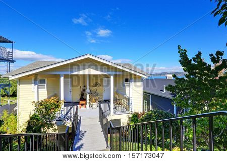 American yellow duplex house on blue sky background. Northwest USA poster