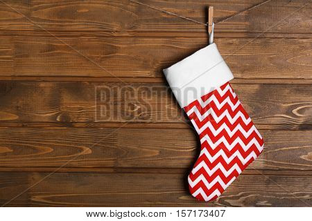 Christmas stocking hanging against wooden wall