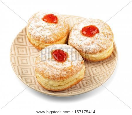 Plate with tasty donuts on white background. Hanukkah celebration concept