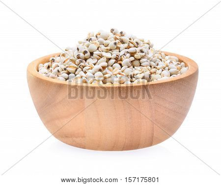 Millet rice millet grains in wooden bowl isolated on white background
