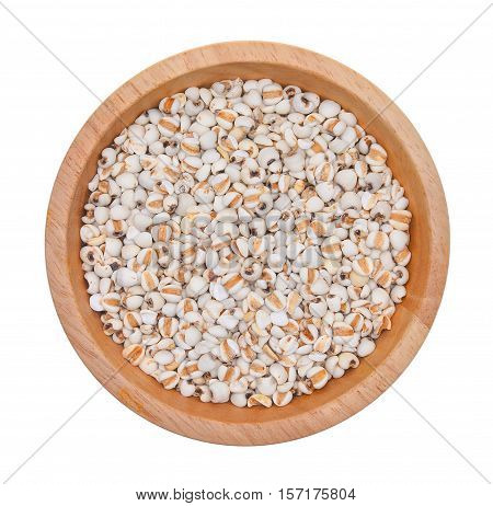 top view of Millet rice millet grains in wooden bowl isolated on white background