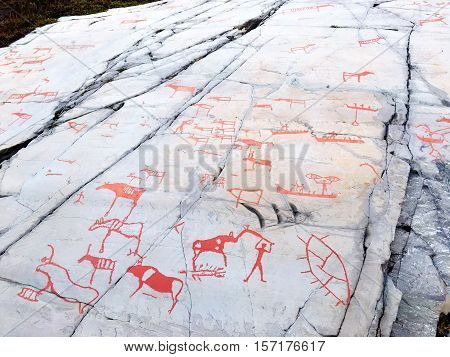 ALTA NORWAY - OCTOBER 09 2016: Rock paintings of primitive hunters and reindeer herders in Alta Norway